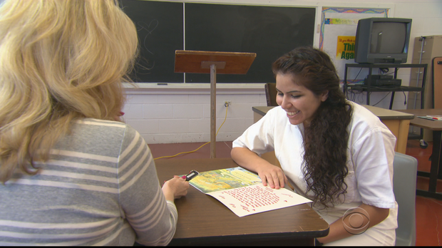 Imprisoned mothers read to their children through Storybook Project – CBS Evening News